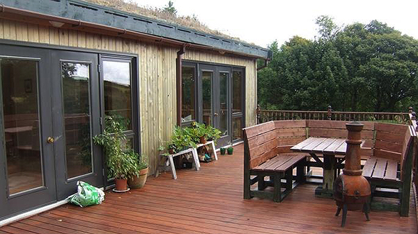 Wiseman Designs - Split Level Grass Roof Timber Clad